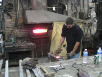 Fence - at G. Krug and Sons - forging fillets (scrolls) by hand - September 28, 2010