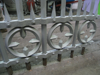Fence - at G. Krug and Sons - detail of circles, bars, and spears after repair and priming.