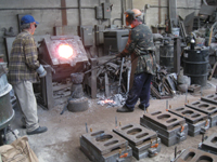 Fence -- Swiss Foundry -- furnace with metal for fence elements. Owner Vojislav Veljko on left.