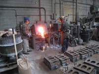 Fence -- Swiss Foundry -- pouring metal for fence elements. Owner Vojislav Veljko on left - September 28, 2010