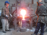 Fence -- Swiss Foundry -- pouring metal for fence elements. Owner Vojislav Veljko on left.