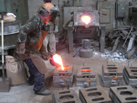 Fence -- Swiss Foundry -- pouring metal into molds for fence elements - September 28, 2010