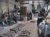 Fence -- Swiss Foundry -- view of foundry with newly poured molds in front - September 28, 2010