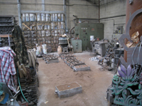 Fence -- Swiss Foundry -- view of foundry from other direction with newly poured molds in front.