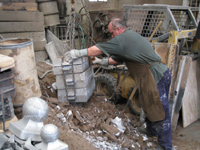 Fence -- Swiss Foundry -- extracting fence elements from cooling molds.
