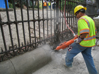 Fence--Removal of cement from bottom of fence on Pennsylvania Ave. side - October 19, 2010