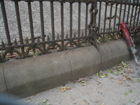 Fence--Detail--Removal of cement from bottom of fence on Pennsylvania Ave. side - October 19, 2010