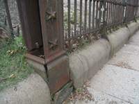 Fence--Detail--Removal of cement from bottom of fence on Pennsylvania Ave. side (northeast corner of fence) - October 19, 2010