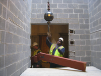 Miscellaneous--Stair elements being lifted into building through the elevator shaft on the second floor - November 1, 2010
