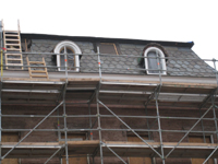 Elevation--West side showing restoration of third floor windows in progress - December 2, 2010