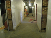 Ground Floor--New concrete floors and drywall in corridor looking east - February 1, 2011