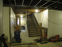 Ground Floor--New concrete floors and plaster in corridor looking north towards north exit - February 1, 2011