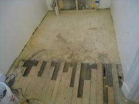Second Floor--West end of corridor--Overlay wood with original wood underneath - March 15, 2011