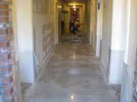 Ground Floor (Basement) --Workers polishing the concrete corridor floor - April 29, 2011