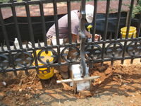 Fence--Applying Jahn mortar to fence base - June 10, 2011